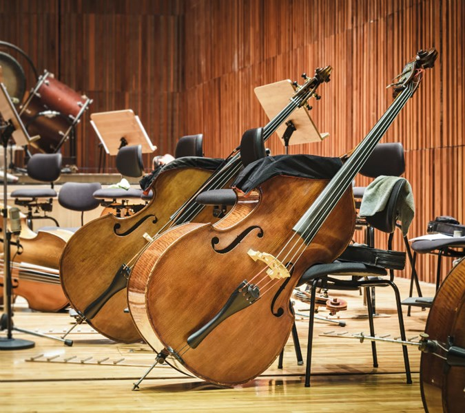 Orchestra Instruments Leaning Against Stools